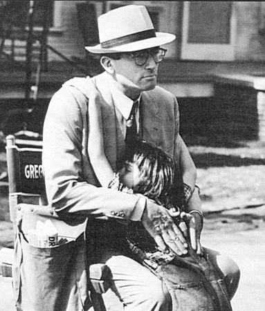 Mary Badham hugs Gregory Peck in a candid shot taken by photographer Leo Fuchs.