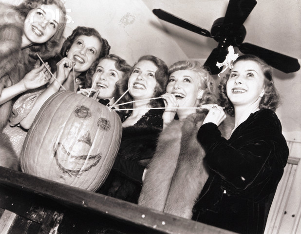 Lana Turner and Friends Drinking from a Pumpkin