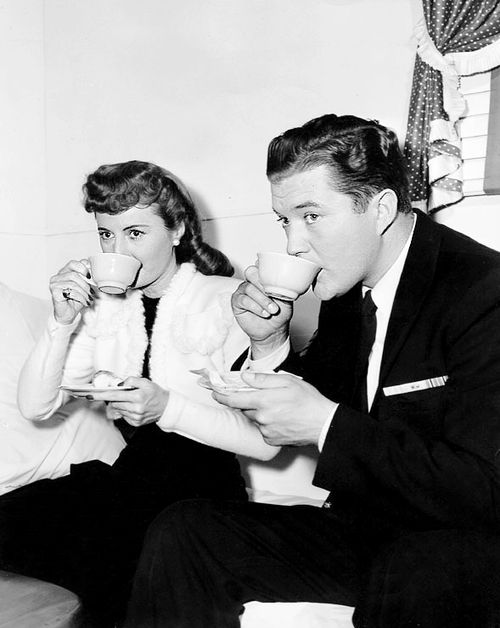 Barbara Stanwyck and Dennis Morgan take a tea break while filming CHRISTMAS IN CONNECTICUT (1945).