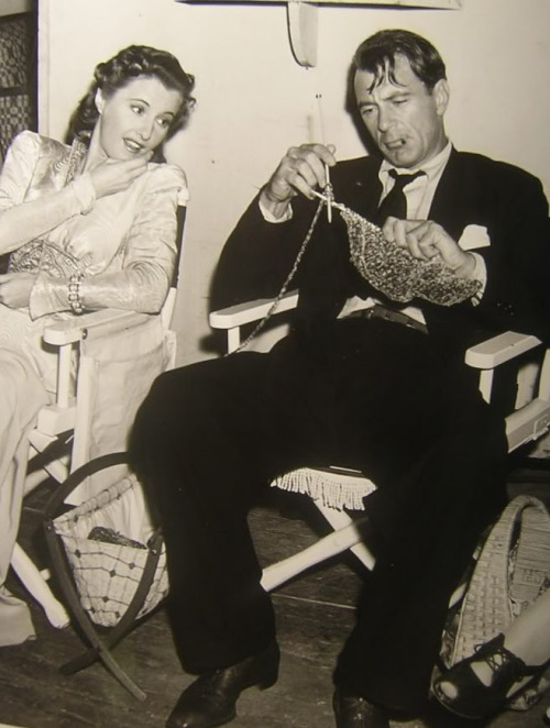 Barbara Stanwyck admiring Gary Cooper's horrible knitting skills during the filming of Frank Capra's MEET JOHN DOE (1941).