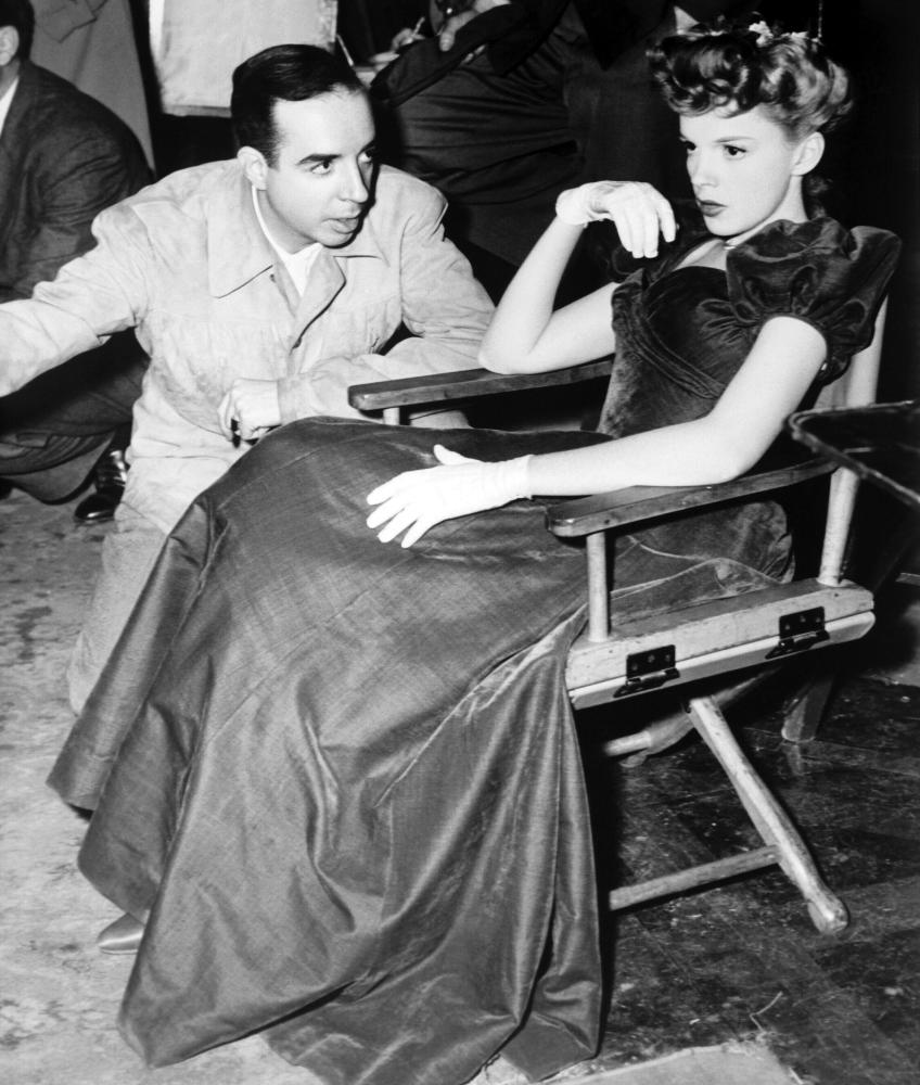 "Vincente Minnelli with his star, and future wife, Judy Garland during the ""Have Yourself a Merry Little Christmas"" scene in MEET ME IN ST. LOUIS (1944)."