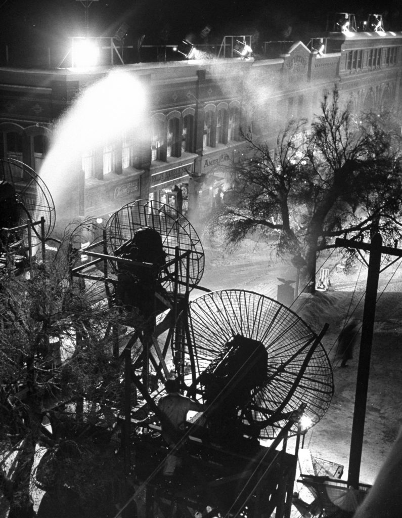 Frank Capra's fictional town of Bedford Falls from IT'S A WONDERFUL LIFE (1946) gets a blanket of snow from a foamite/soap machine.