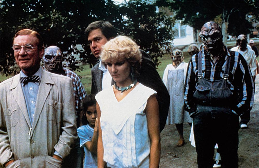 STRANGE INVADERS, humans from left: Kenneth Tobey, Lulu Sylbert (child), Paul Le Mat (rear), Diana Scarwid, 1983, © Orion