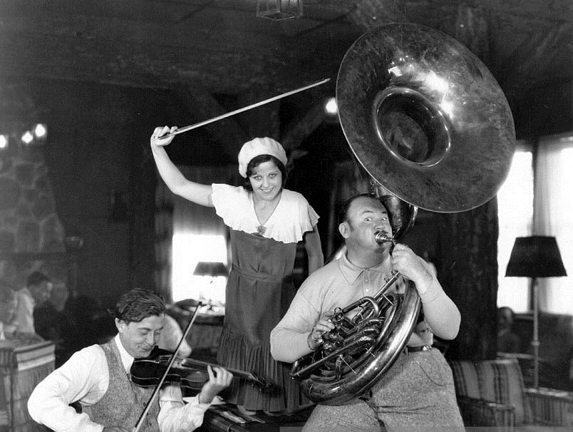 Paul Whiteman, right, mugs for the camera during filming of KING OF JAZZ.