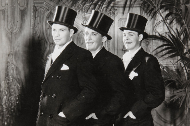 "Bing Crosby, center, with Harry Barris and Al Rinker in Paul Whiteman's ""The Rhythm Boys"""