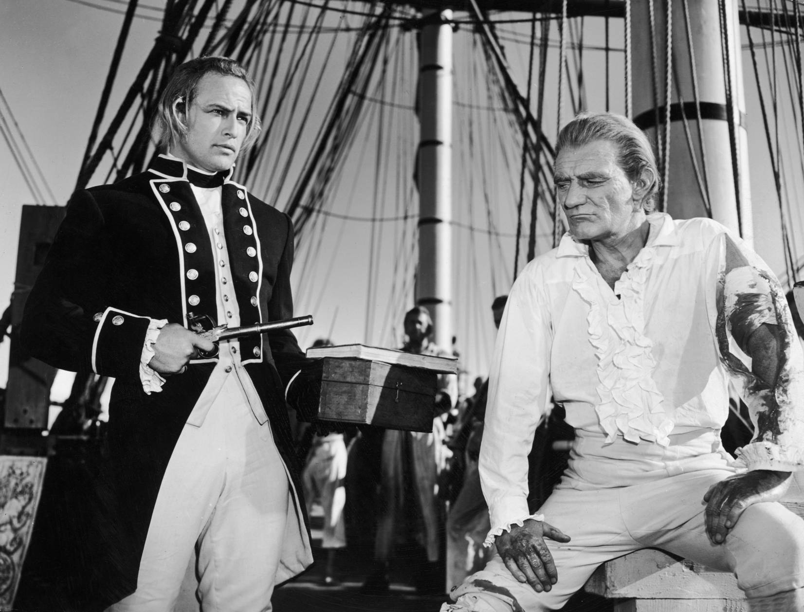 Marlon Brando as Fletcher Christian and Trevor Howard as Captain Bligh, 1962