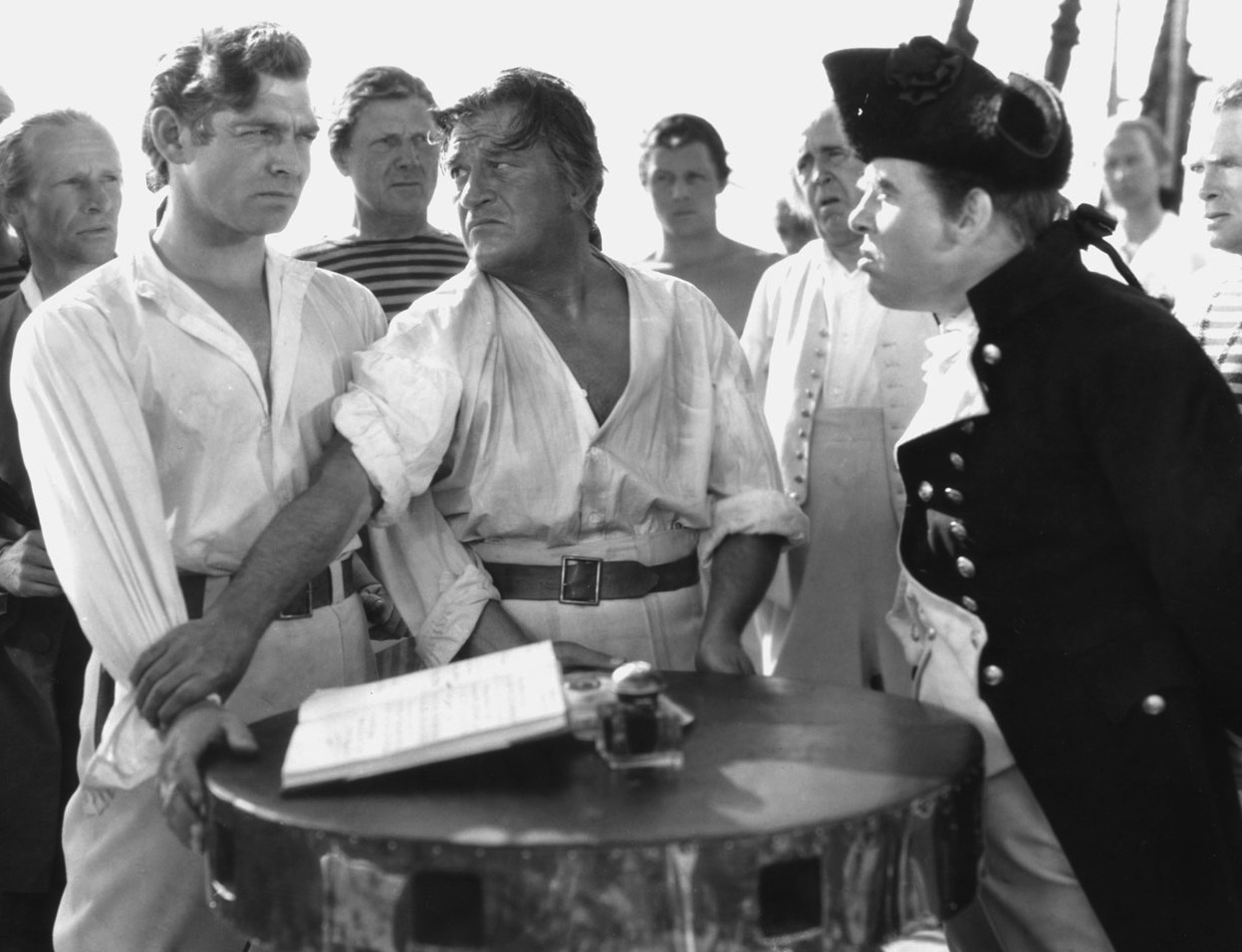 Clark Gable, left and Charles Laughton, far right, in the 1935 Mutiny on the Bounty